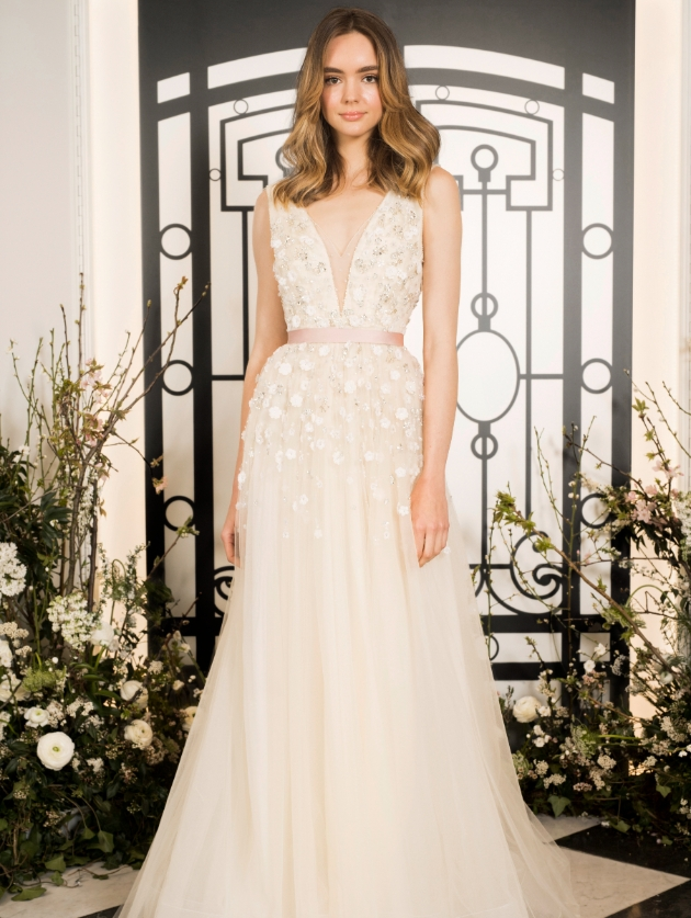 Blush pink wedding dress with flower applique and belt