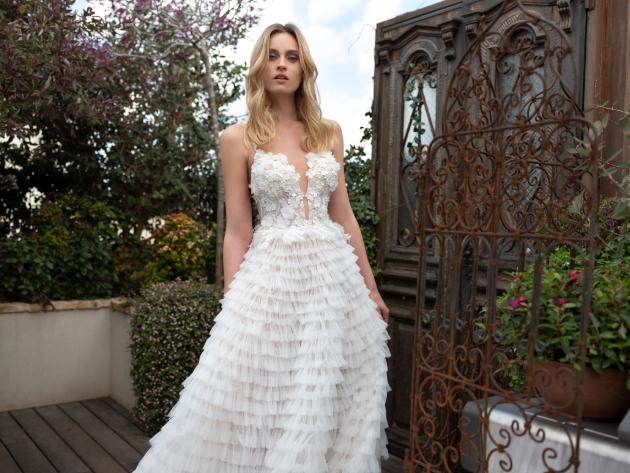 Ruffle skirt wedding dress wth appliqué floral bodice