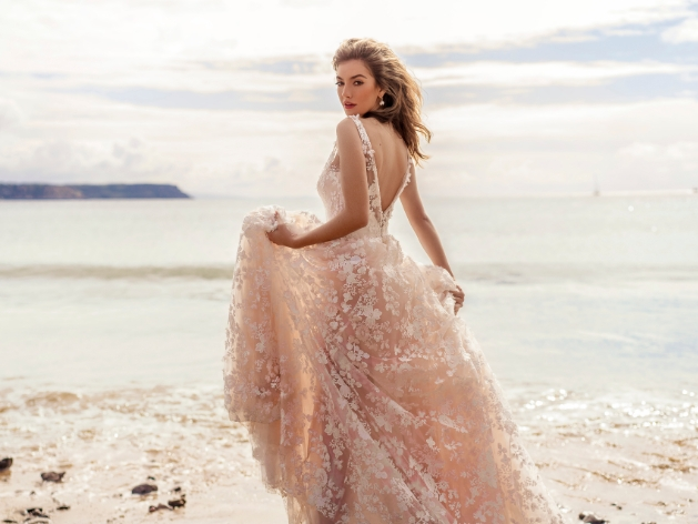 Blush coloured wedding dress with all over flowers