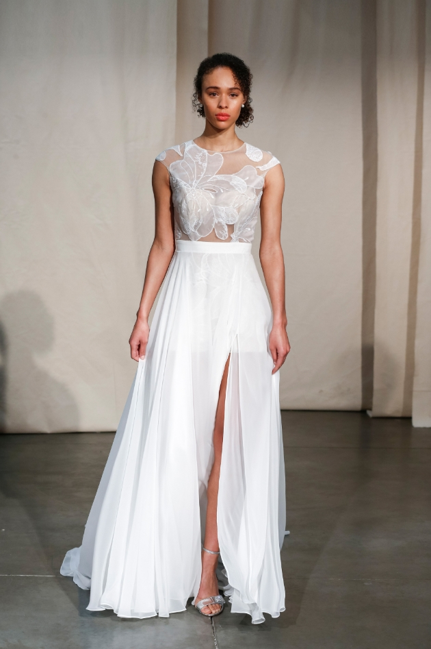 Justin Alexander wedding dress with see-through corset top with flowers