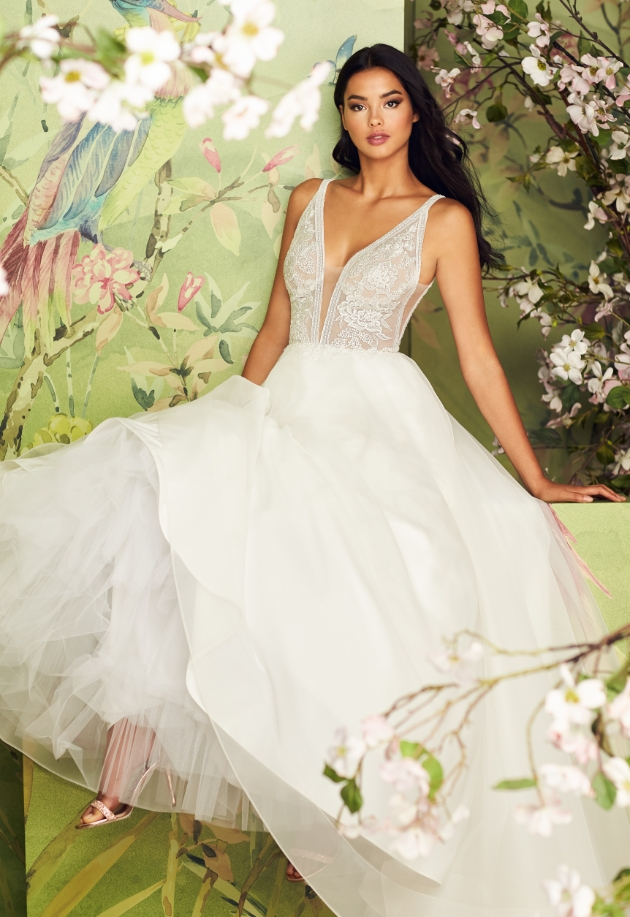 Large full skirted wedding dress with flower detail corset