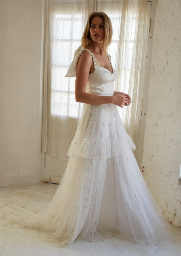 Model wears wedding dress with layered effect