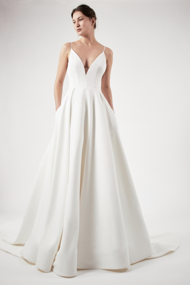 Front view of model in a wedding dress which is simple and no detail