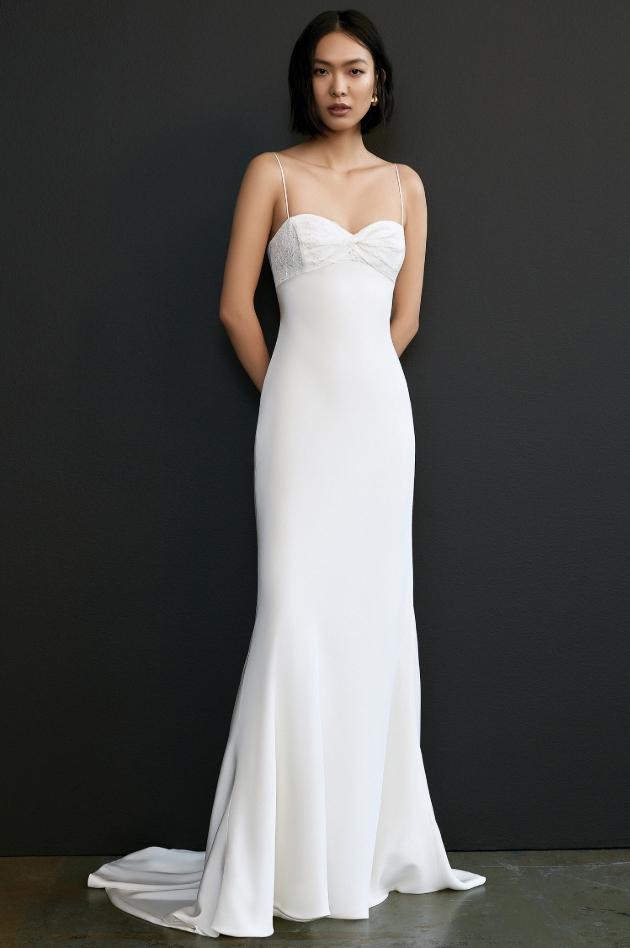 Model wears a slimline plain Savannah Miller white gown