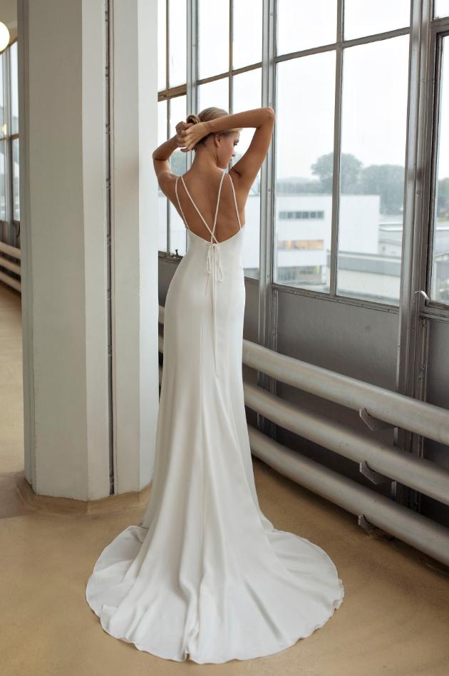 Back shot of model wearing wedding dress with thin spaghetti straps