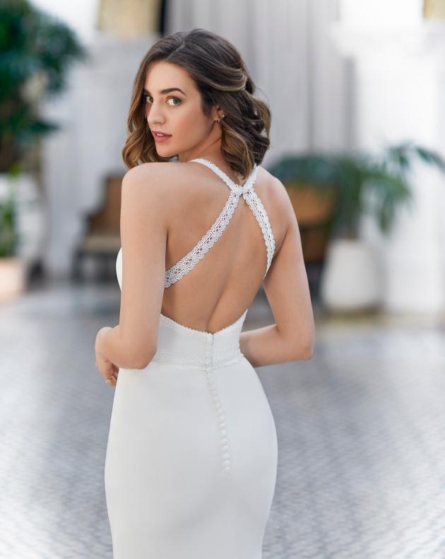Back of wedding dress on model with large back straps