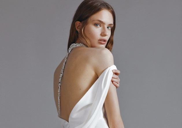 Back shot of model wearing wedding dress with a large diamante back strap
