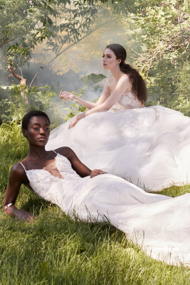 Two models in the woods wearing different style gowns