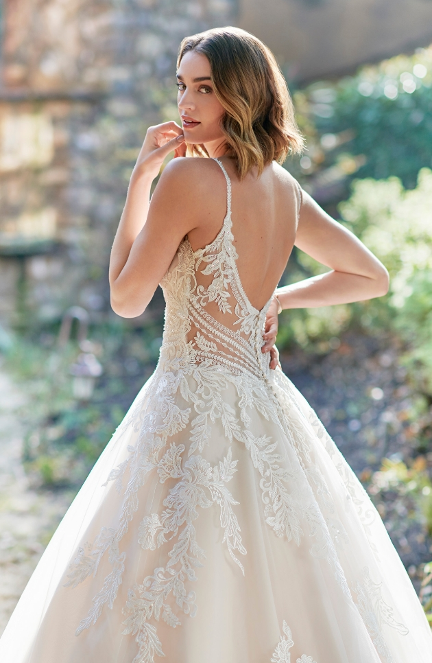bride looking at camera over her shoulder in a dress made of Embroidered Cotton Lace/English Net/Organza/Stretch Lining