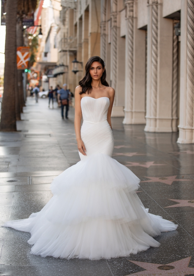 Model in the streets wearing a fishtail wedding dress