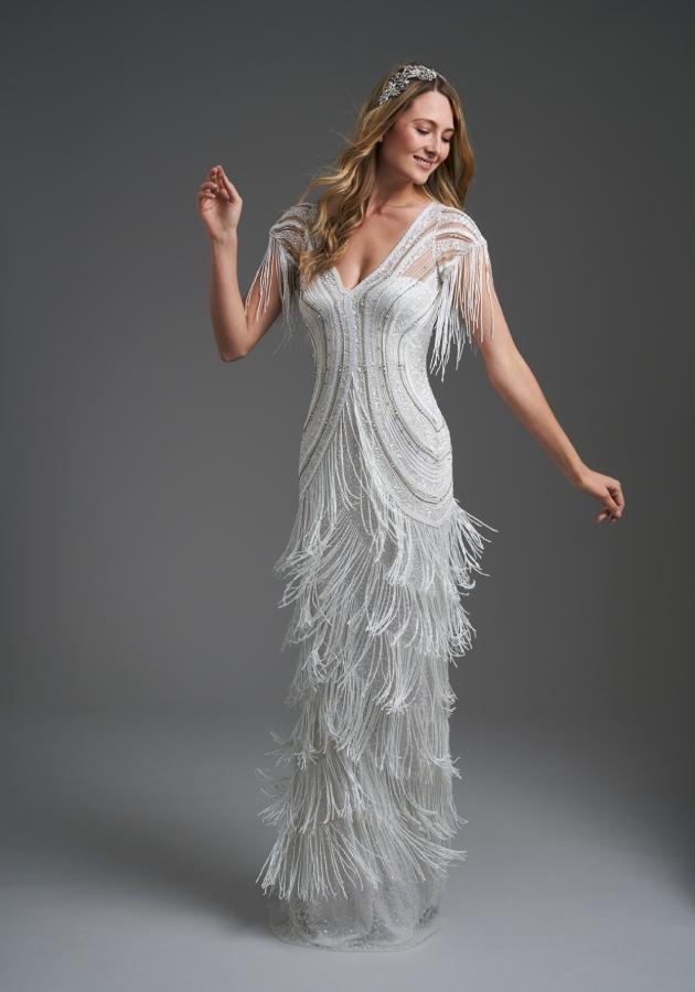 Model in a studio wearing a vintage=-style dress