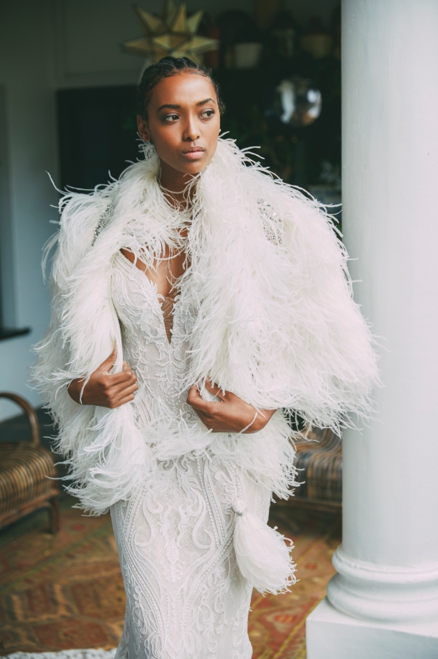 Bride wearing a larger feathered shawl from Anna Georgina