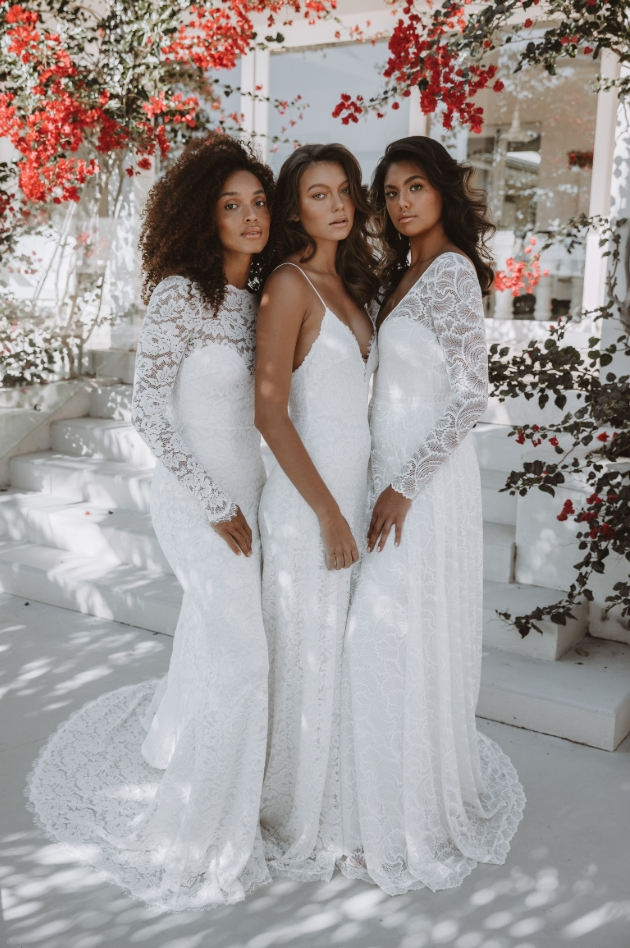 Three models in a group two with long sleeved dresses