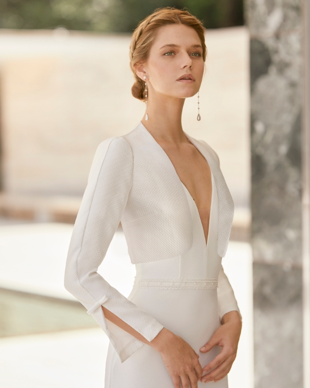 Model wear wedding dress and jacket with fluted sleeves