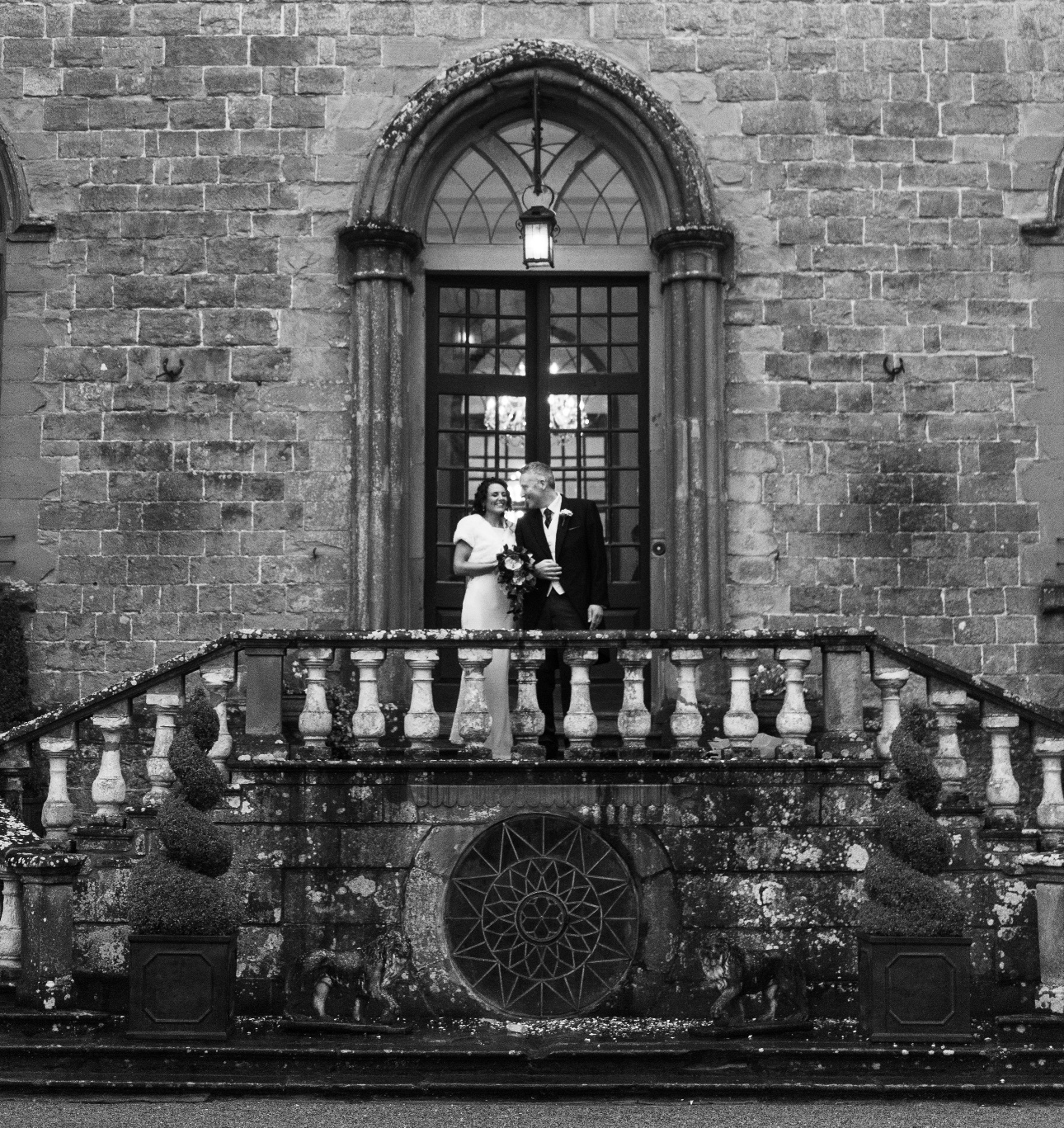 Couple on steps of castle