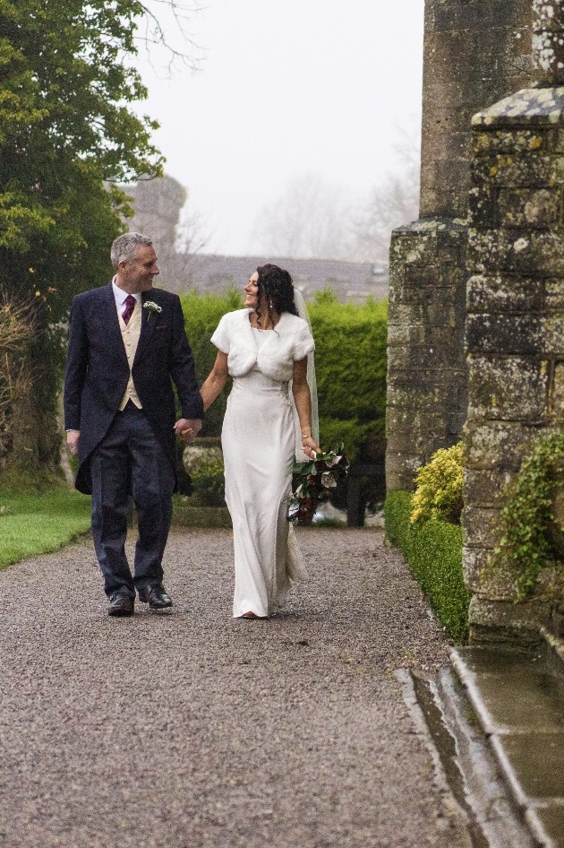 Couple walking throguh grounds